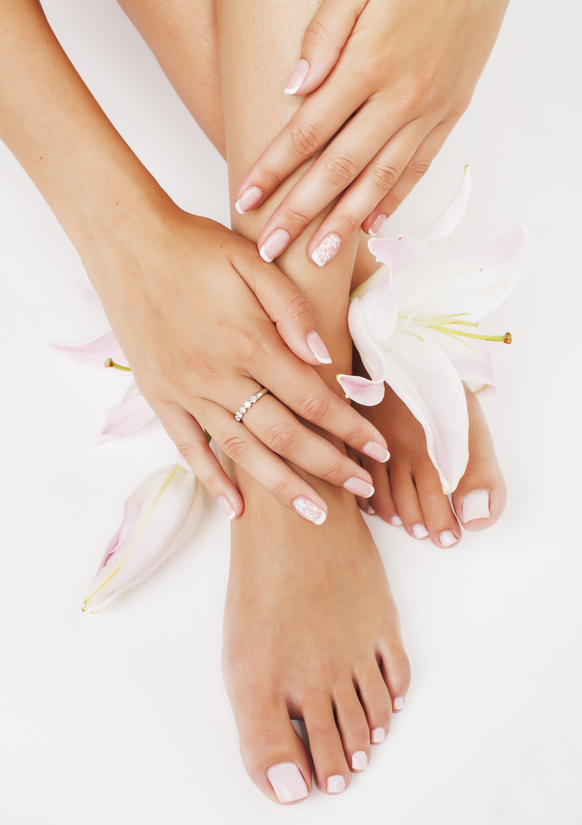 manicure pedicure with flower lily close up isolated on white